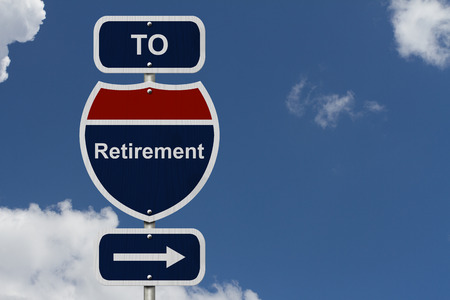 Retirement this way, Blue and Red Interstate Sign with word Retirement and an arrow with sky background photo