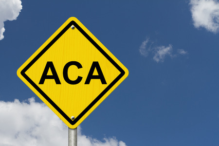 ACA Warning Sign for Affordable Care Act, An American road warning sign with word ACA with a blue sky background photo