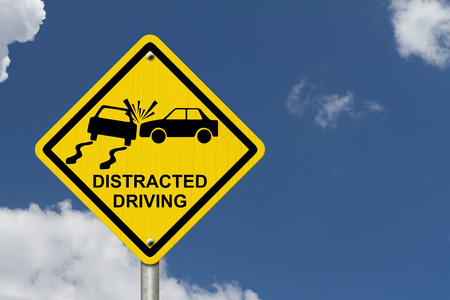 texting: No Distracted Driving Sign, Yellow warning sign with words Distracted Driving and accident icon with sky background Stock Photo
