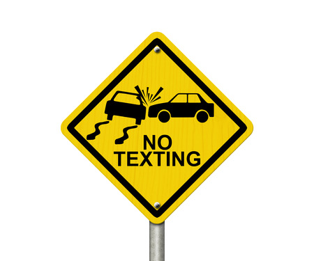 No Texting While Driving Sign, Yellow warning sign with words No Texting and accident icon isolated on white photo