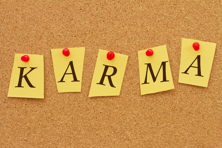 inform information: Karma, Four yellow notes on a cork board with the word Karma Stock Photo