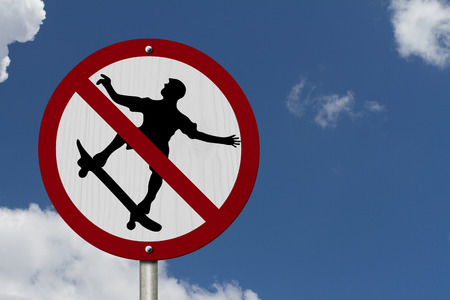 No Skateboarding Allowed Sign, An red road sign with skateboarder icon and not symbol photo