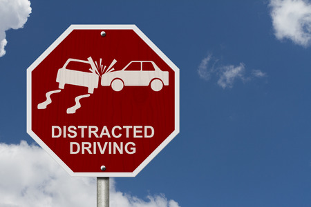No Distracted Driving Sign, Red stop sign with words Distracted Driving and accident icon with sky background photo