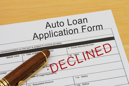 borrowing: Auto Loan Application Form with declined stamp and a pen on a wooden desk Stock Photo