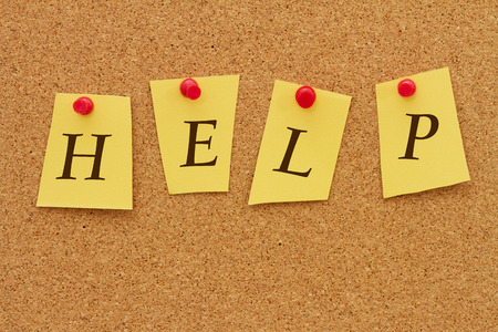 inform information: Help Notice, Four yellow notes on a cork board with the word Help