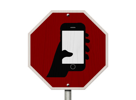 No Texting and Driving Sign, Red Stop sign with symbol of a hand and texting isolated on a white background photo