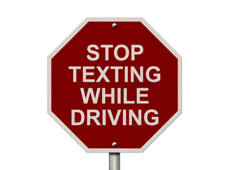 Stop Texting While Driving Sign, Red and White Stop sign with words Stop Texting While Driving isolated on white photo