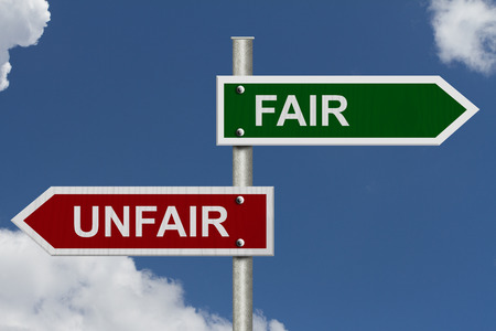 unfair: Red and green street signs with blue sky with words Fair and Unfair, Fair versus Unfair