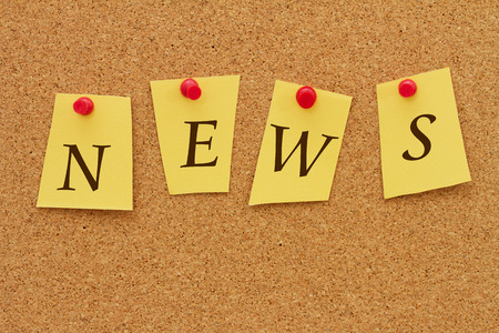 inform information: News Board, Four yellow notes on a cork board with the word NEWS