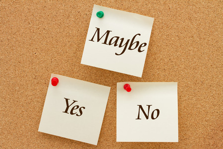 maybe: Yes, No and Maybe, Three yellow sticky notes on a cork board with the words Yes, No and Maybe