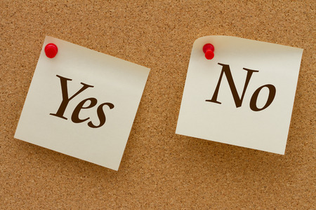 affirm: Yes versus No, Two yellow sticky notes on a cork board with the words Yes and No