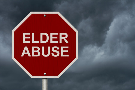 Stop Elder Abuse Sign, An American road stop sign with words Elder Abuse with stormy sky background