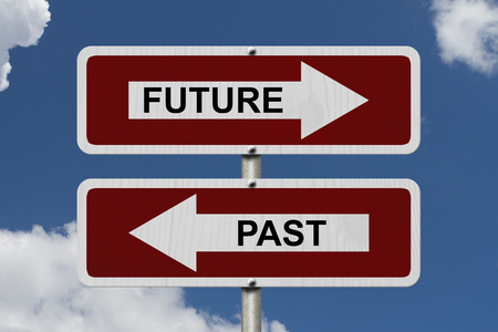 Future versus Past, Red and white street signs with words Future and Past with sky background