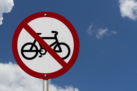 No Bikes Allowed Sign, An red road sign with bike icon and not symbol with blue sky background