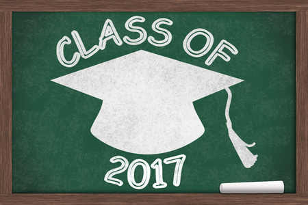 Class of 2017 Message, Class of 2017 written on a chalkboard with chalk and a grad cap Banco de Imagens - 31588379