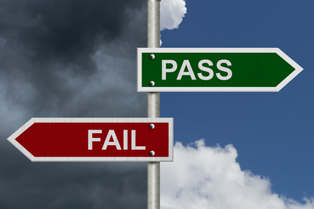 Red and Green street signs with blue and stormy sky with words Pass and Fail, Pass versus Fail Stock Photo