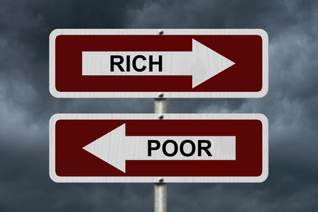 Rich versus Poor, Red and white street signs with words Rich and Poor with stormy sky background photo