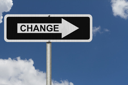 The way to Change, Black and white street sign with word Change with sky background photo