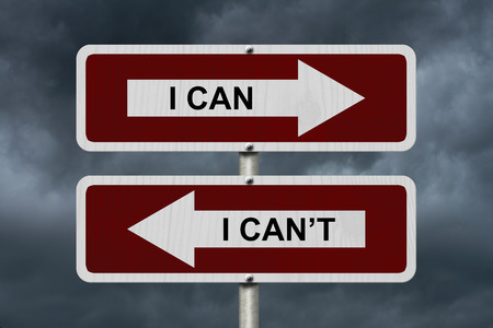 cant: I can versus I can not , Red and white street signs with words I Can and I Cant with stormy sky background Stock Photo