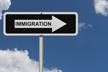immigrate: The way to Immigration, Black and white street sign with word Immigration with sky background