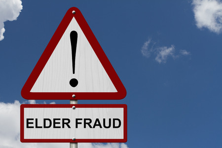Elder Fraud Caution Sign, Red and White Triangle Caution sign with word Elder Fraud with sky background