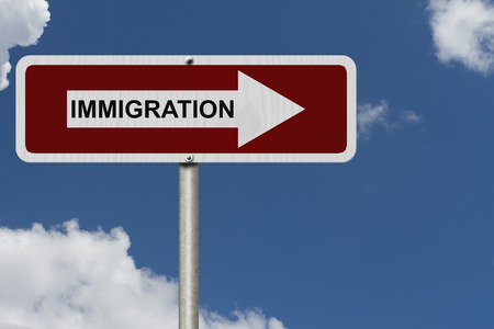 immigrate: The way to Immigration, Red and white street sign with word Immigration with sky background Stock Photo