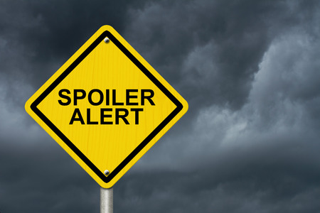 disclosed: Spoiler Alert Warning Sign, An yellow caution road sign with text Spoiler Alert with stormy sky background