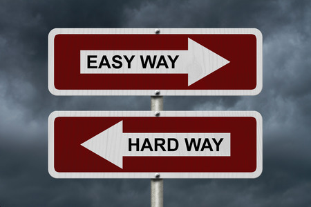 hard way: Hard Way versus Easy Way, Red and white street signs with words Hard Way and Easy Way with stormy sky background Stock Photo