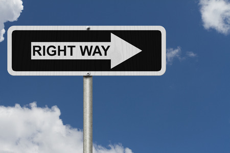 right of way: This is the right way, Black and white street sign with word Right Way with sky background Stock Photo