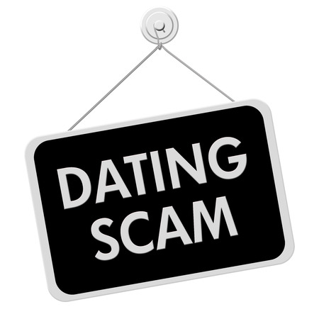 A black and white sign with the words Dating Scam isolated on a white background photo