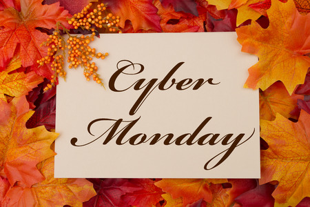bargain: A Cyber Monday card, A beige card with words Cyber Monday over red and orange maple leaf background