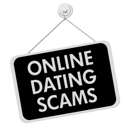 A black and white sign with the words Online Dating Scam isolated on a white background photo