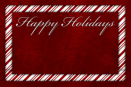 copyspace: A Happy Holidays card, A Candy Cane border with words Happy Holidays over red plush background with copy-space