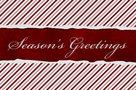 candy stripe: A Seasons Greetings card, A Candy Cane Stripes with words Seasons Greetings over red plush background