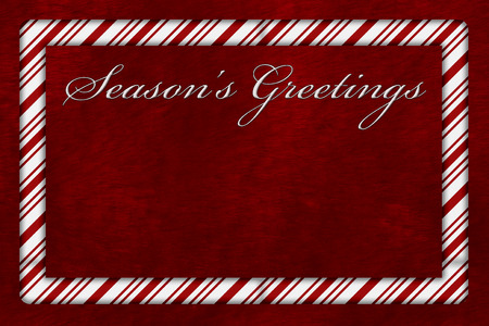 candy stripe: A Seasons Greetings card, A Candy Cane border with words Seasons Greetings over red plush background with copy-space