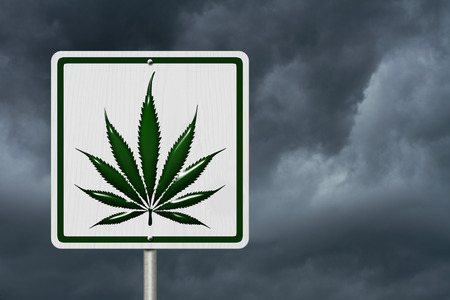 under the influence: Driving Under the Influence of  Marijuana, A road highway sign with a marijuana leaf with stormy sky background Stock Photo