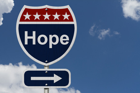 highway sign: Hope Sign, A red, white and blue highway sign with word Hope and an arrow sign with sky background