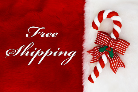 Free Shipping, A plush red stocking with a Candy Cane and words Free Shipping photo