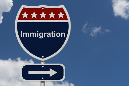 Immigration this way sign, Blue, Red and White highway sign with words Immigration with sky background photo