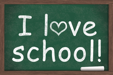i like my school: I love school, I love school written on a chalkboard with a piece of white chalk