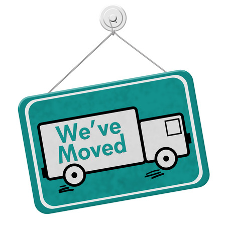 We have Moved Sign,  A teal sign with the word Weve Moved with a truck isolated on a white background Stock Photo