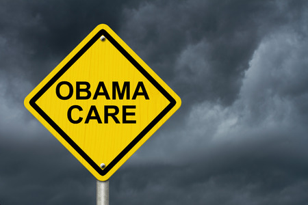 obama care: ObamaCare Warning Sign, Yellow warning road sign with word ObamaCare with stormy sky background Stock Photo
