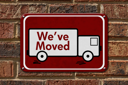 relocate: We have Moved Sign,  A red sign with the word Weve Moved with a truck on a brick wall