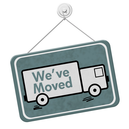 overwhite: We have Moved Sign,  A blue sign with the word Weve Moved with a truck isolated on a white background Stock Photo