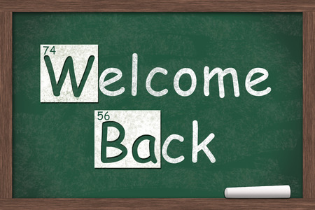 welcome desk: Welcome Back, Welcome Back written on a chalkboard with letters from the periodic table and a piece of white chalk Stock Photo