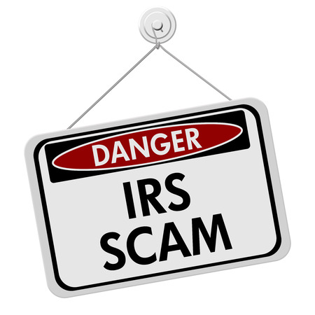 A red and white sign with the words IRS Scam isolated on a white background photo