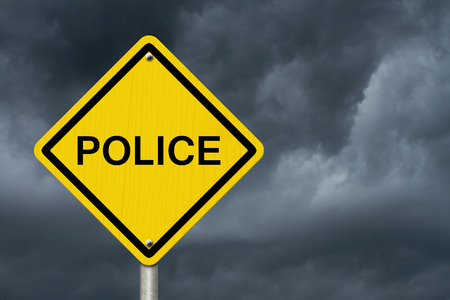 unjust: Caution sign with word Police with stormy sky background Stock Photo