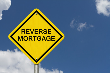 reverse: Reverse Mortgage Caution Road Sign, Caution sign with word Reverse Mortgage with sky background