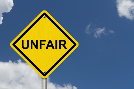 unfair: Unfair Caution Road Sign, Caution sign with word Unfair with sky background