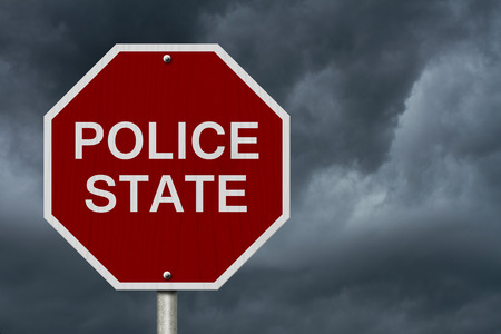 police state: Stop Police State Road Sign, Stop sign with words Police State with stormy sky background